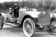 Lou Kings at the wheel of an early Austin